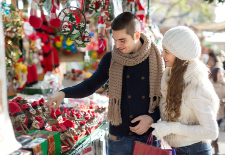 barcelona: Happy married couple at Catalan Christmas market. smiling Stock Photo