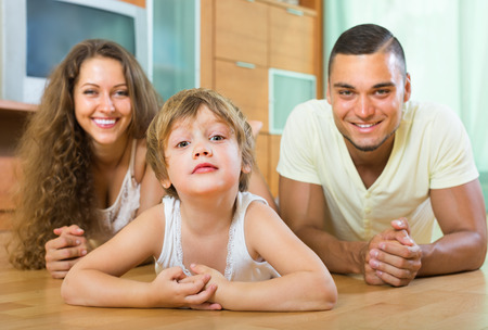 3 4 years: Young parents with four-year child in home interior. Focus on girl
