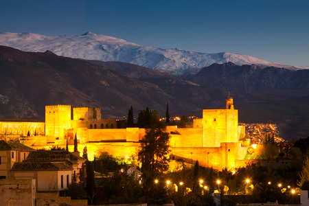 the  alhambra: Night view  of  Alhambra with Sierra Nevada in  Granada. Spain