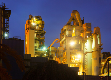 cement chimney: view of industry plant in evening Stock Photo