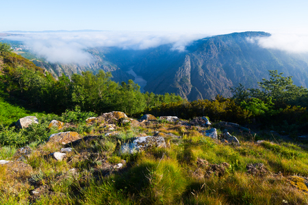sil: Mountains landscape with fog over river  in summer.  Galicia, Spain