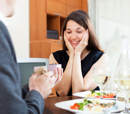 affiance: man give ring to his girl at a romantic dinner