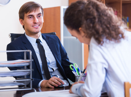 new employee: Young professional teaching new employee in practice  inside
