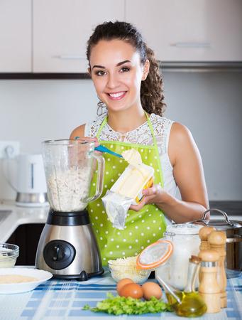 liquidiser: Happy woman preparing chicken pate in domestic kitchen