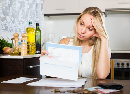 ruminate: Sad  young woman thinking about the financial problems  at home Stock Photo
