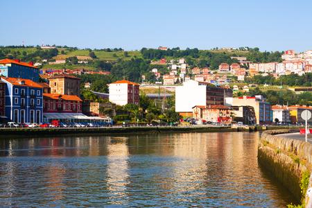 spanish homes: Embankment of  Ibaizabal river and residential houses. Bilbao, Spain