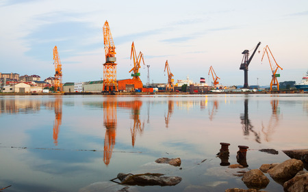 seaport: Morning view of   cranes  in cargo seaport of Maliano. Santander, Spain