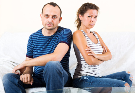 sorting out: Young sad family sorting out their relationship Stock Photo