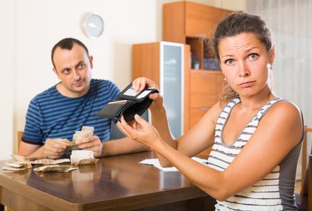 finacial: Casual american family having finacial problems and debts