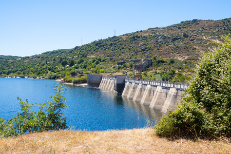prada: Dam at Encoro de Prada in sunny day.   Spain Stock Photo