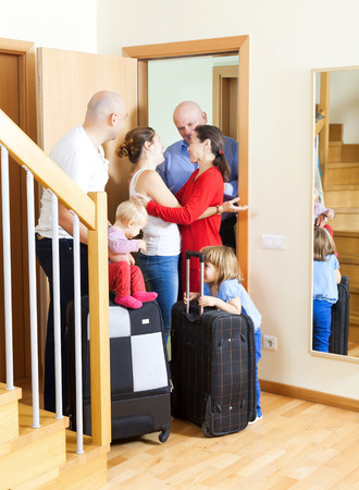 relatives: Family arrived to visit relatives at door of home Stock Photo
