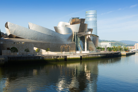 frank   gehry: BILBAO, SPAIN - JULY 4, 2015:  Guggenheim Museum Bilbao is  museum of modern and contemporary art by Canadian-American architect Frank Gehry. Bilbao, Basque Country