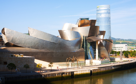 cityspace: BILBAO, SPAIN - JULY 4, 2015:  Guggenheim Museum Bilbao is  museum of modern and contemporary art, designed by Canadian-American architect Frank Gehry