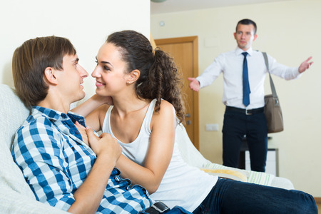 coming home: Upset man coming home and seeing girlfriend cheating on him