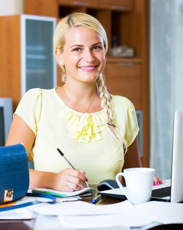 yuppie: Portrait smiling young girl working at laptop at home