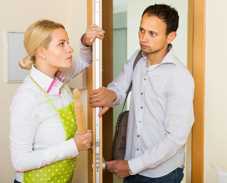 rollingpin: Angry woman threatens with rolling-pin for a frightened man