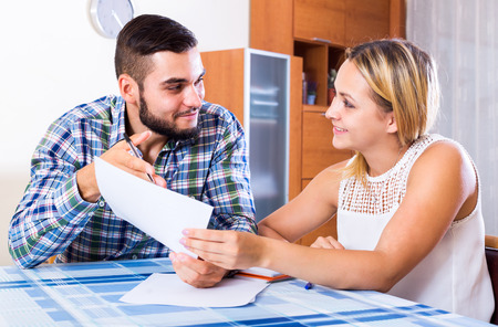 middle joint: Portrait of happy young woman and her husband with papers Stock Photo