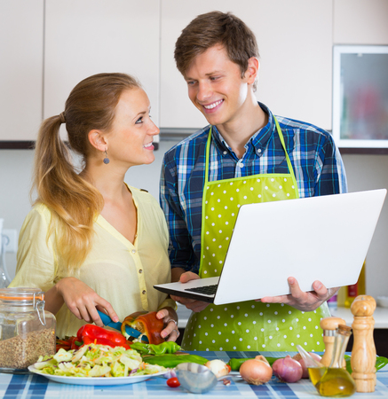 browsing the internet: Young couple browsing internet for recipe Stock Photo