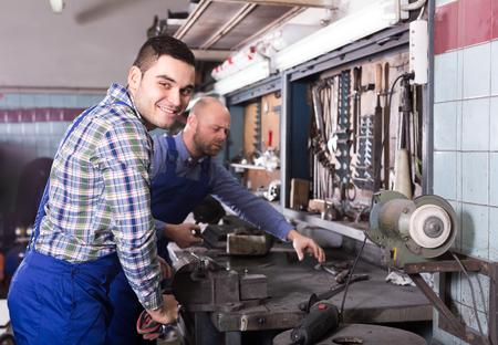 hardware repair: Men working with hardware in a repair shop