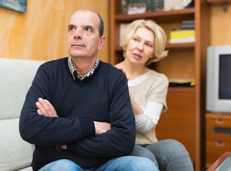 flatter: Guilty mature wife asking husband for forgiveness