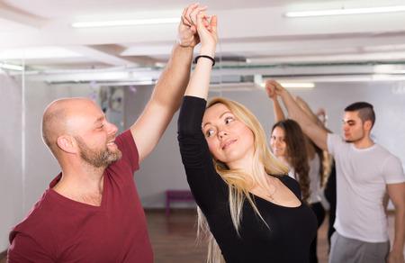 unprofessional: Happy 40 years old  people having dancing class indoors