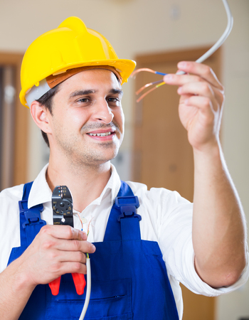dimmer: Professional electrician working with wires at client home Stock Photo