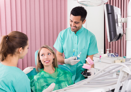 operative: Portrait of doctor and positive patient at dental clinic