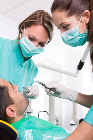 odontology: Patient and dental clinic crew during check up at clinic Stock Photo