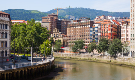 the river: BILBAO, SPAIN - JULY 4, 2015:  Residential houses at embankment of  Ibaizabal river . Bilbao, Spain