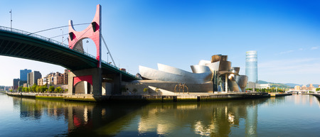 salve: BILBAO, SPAIN - JULY 4, 2015:  Panoramic view of La Salve Bridge and Guggenheim Museum. Bilbao, Basque Country