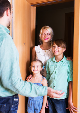threshold: Happy guests coming at threshold with visit to friend. Focus on woman