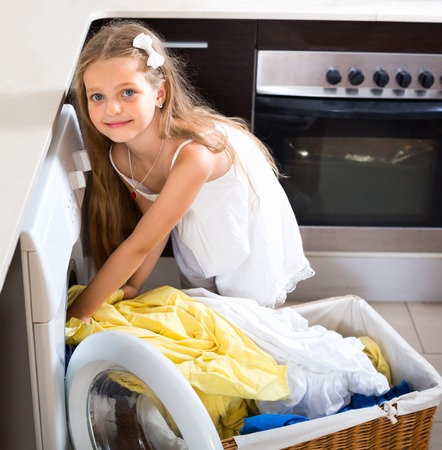washed: Smiling girl enjoying the smell of washed clothes