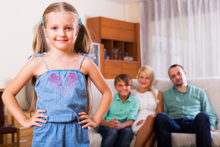 2 people at home: Happy family with two kids on couch indoors Stock Photo