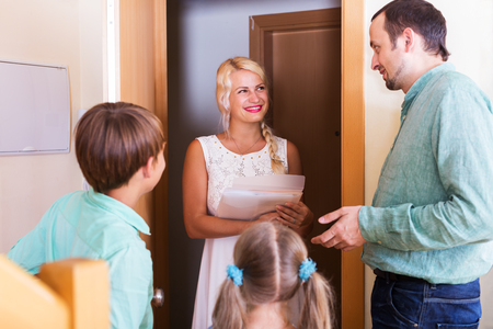 threshold: Woman coming at threshold with visit to friends family Stock Photo