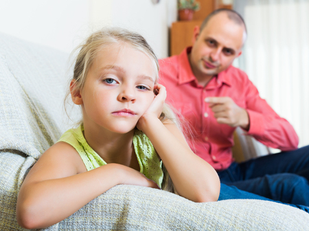lecturing: Annoying dad giving instructions to frustrated little girl at home