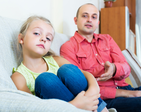 admonition: Annoying dad giving instructions to frustrated little girl in livingroom