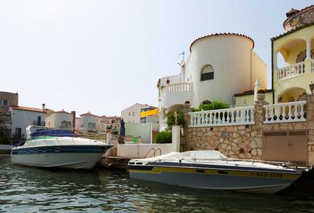 waterways: EMPURIABRAVA, SPAIN - MAY 14, 2015: Homes and waterways at residential marina. Empuriabrava -  largest residential marina in Europe