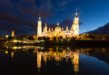 ebro: Autumn view of Cathedral in Zaragoza from Ebro river in evening.  Spain