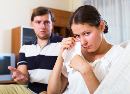 condone: Woman crying after bad quarrelling with husband at home Stock Photo