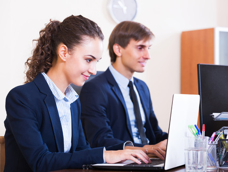 successfully: Positive office colleagues successfully working together indoors Stock Photo