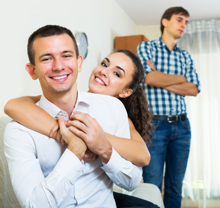 suitor: Ex-lover watching happy girlfriend leaving him for another man indoors