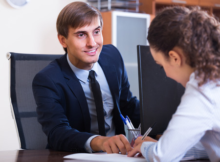 new employee: european professional teaching new employee in practice at company Stock Photo