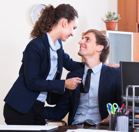 the seducer: playful manager flirting with assistant  in office