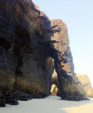 falling tide: Natural arch at  As Catedrais beach in  day time