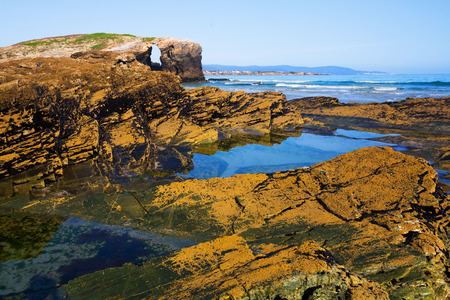turistic: Stone coast at  As Catedrais beach - it is the turistic name of Praia de Augas Santas (Beach of the Holy Waters). Galicia,  Cantabric coast. Spain