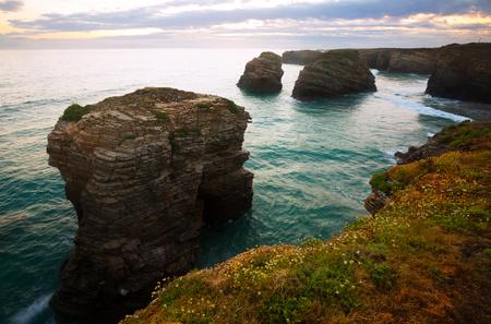 influx: Rocks at  Atlantic Ocean coast of Spain in  sunrise