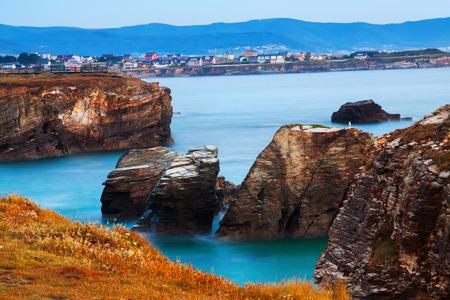influx: Rocks at  Atlantic Ocean coast of Spain in  evening