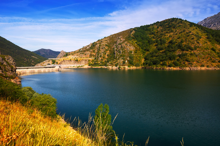 castile leon: landscape with lake. Barrios de Luna reservoir with dam. Leon,  Spain