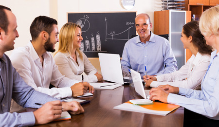 Smiling business people during conference call indoors