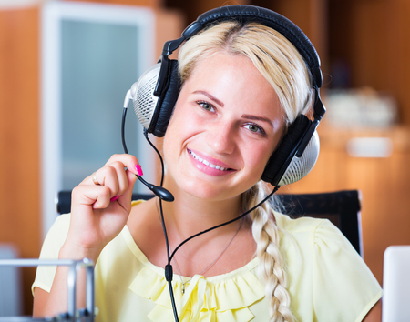 25s: Portrait of happy young call center operator in office